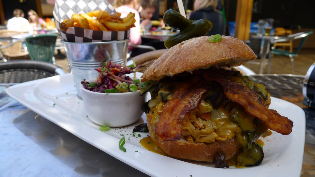 "The magnificent Cadillac ""Boss"" Yardbird: Applewood-Smoked Pulled Chicken Sandwich with Sautéed Mushrooms, Smoked Bacon, Aged Cheddar, Zesty Root Slaw, Mustard Barbecue Sauce… and Fries"