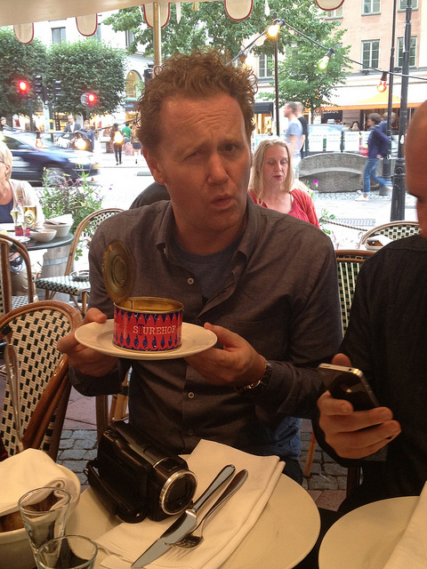 Jamie Drummond samples Surströmming for the first time at Stockholm institution Sturehof