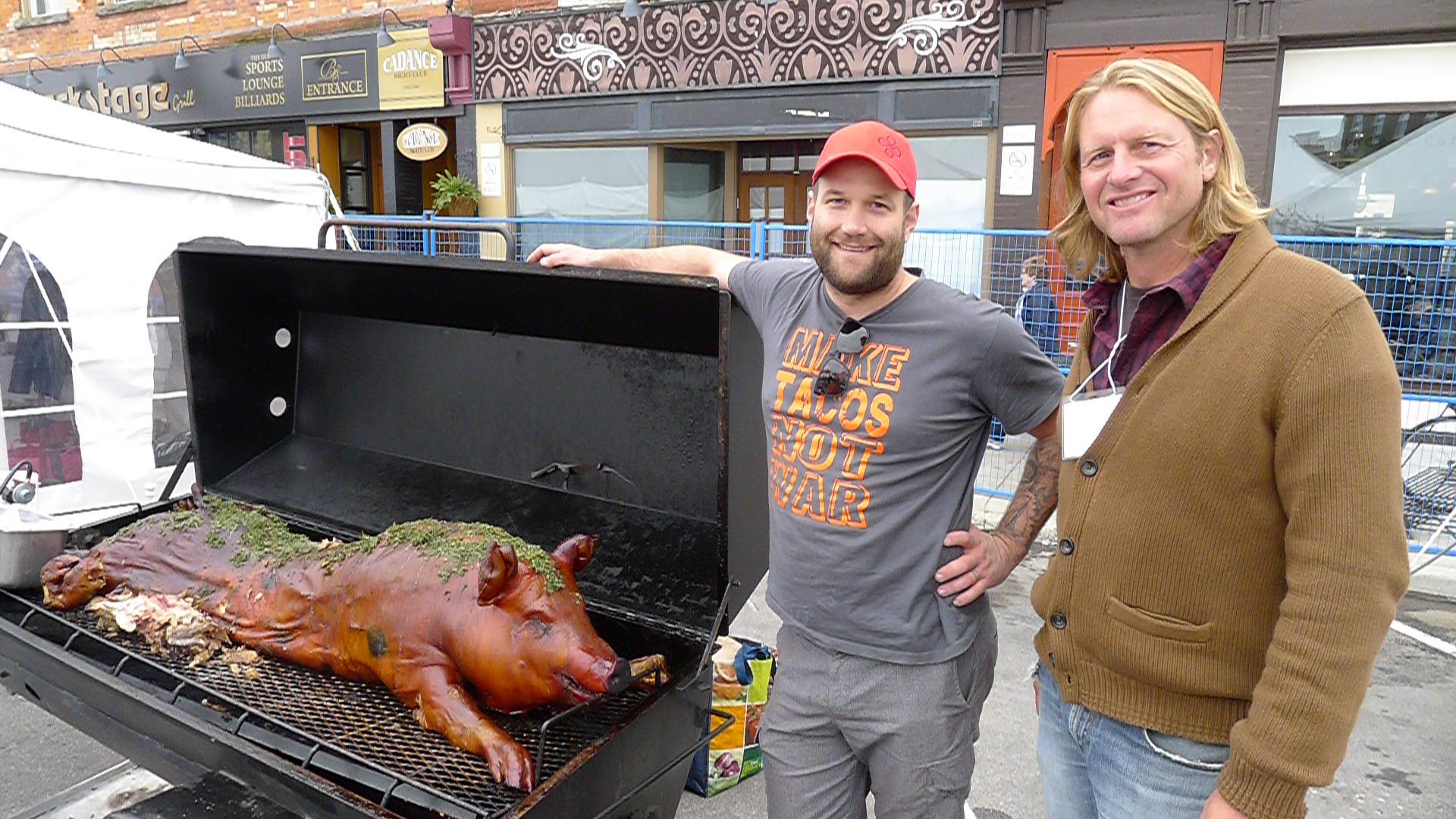 Chef Nick Benninger and Farmer Mark Lass proudly show off their very special pig roast.