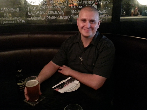 Jesse Vallins enjoying a beer at The Saint, Toronto.