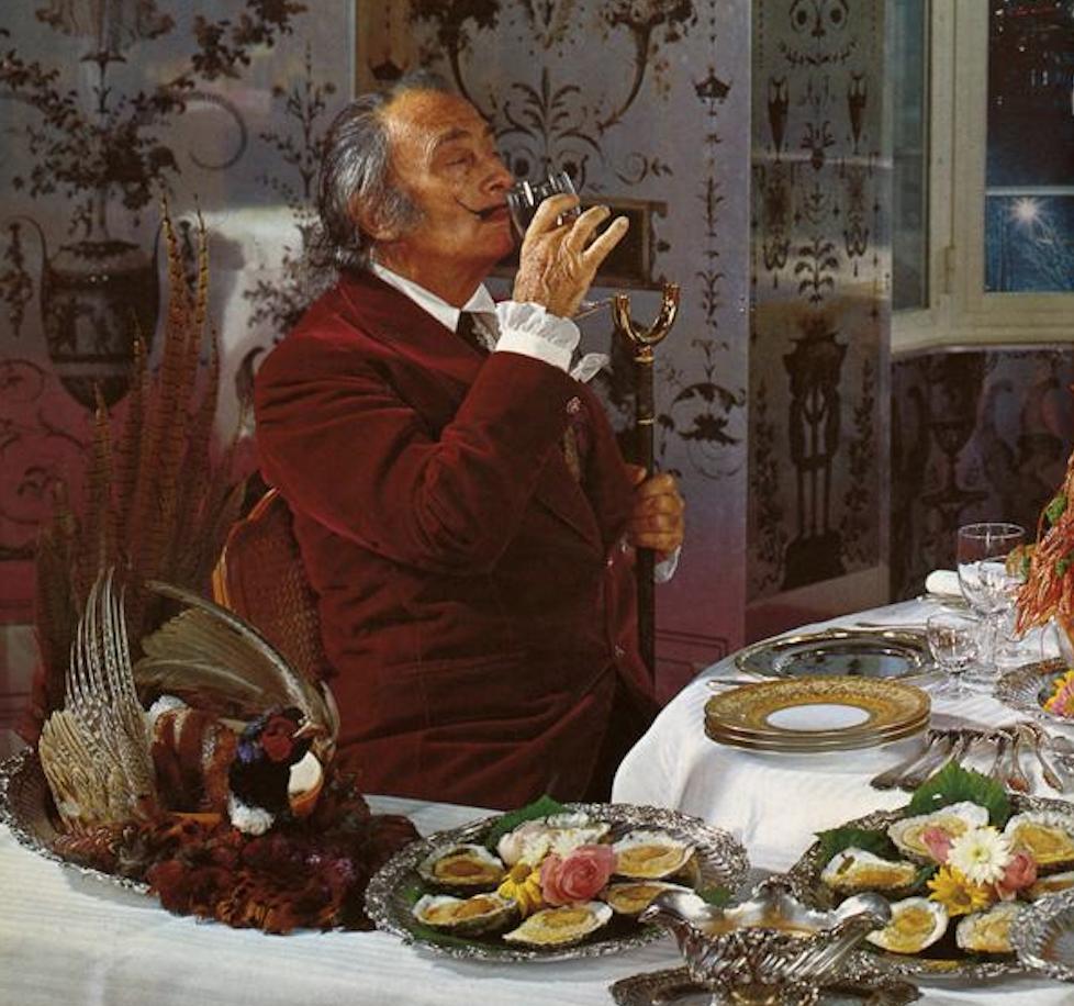 Salvador Dali enjoys a glass of wine