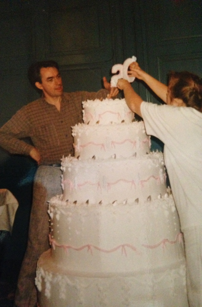 """""""Donna and I topping off a cake for some company's 20th anniversary. Cake is styro with twinkly lights inset and shortening and sugar frosting. It was an engineering exercise - not catering."""""""