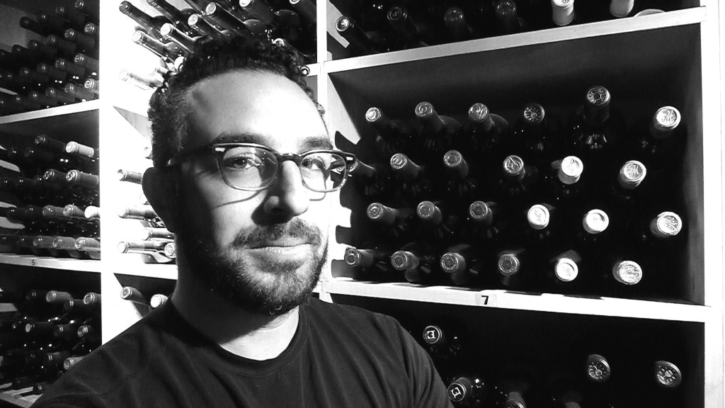 A very serious-looking Jascha Baraness in Barberien's wine cellar.