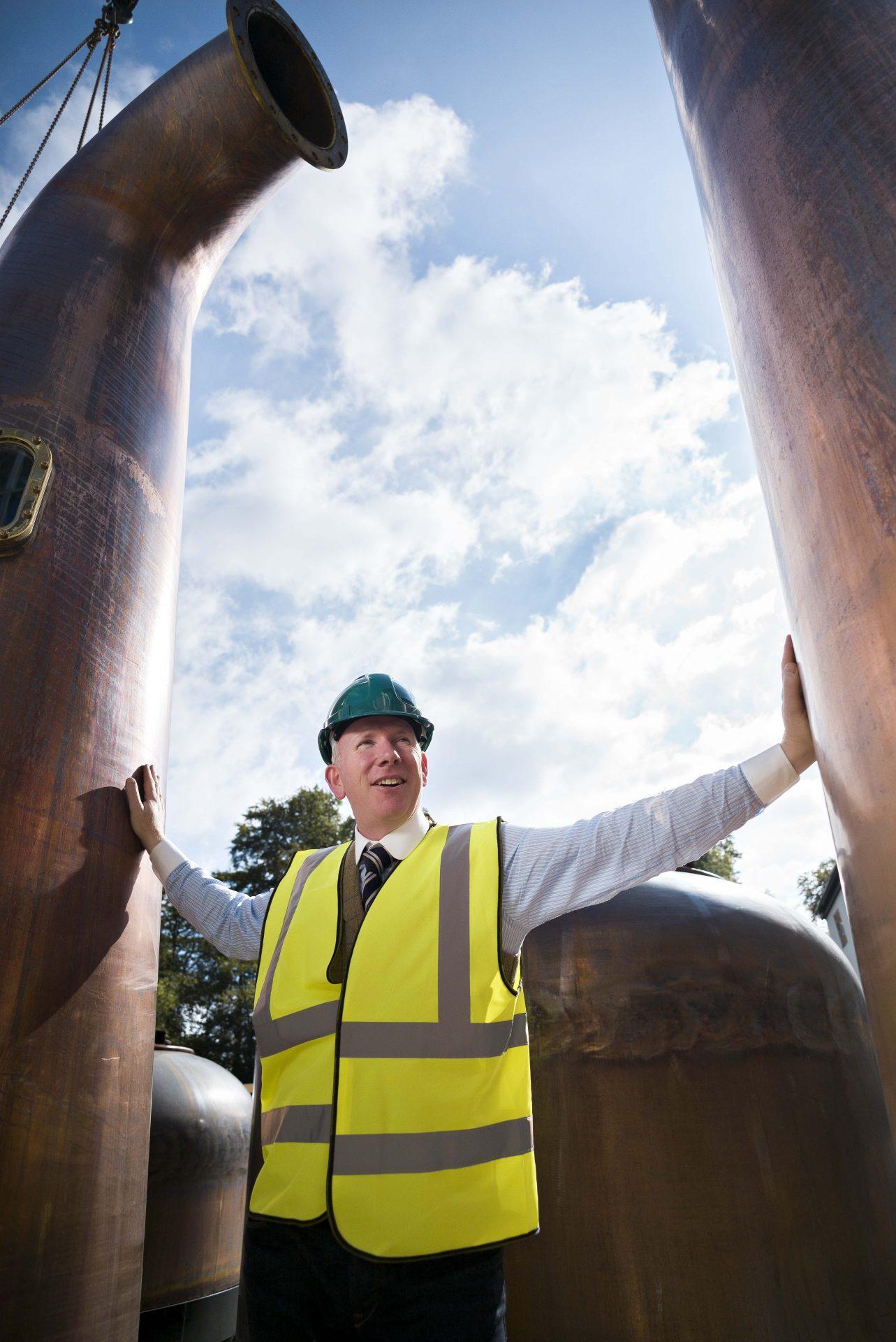 Bernard Walsh surveys the copper pots at Walsh Whiskey Distillery at Royal Oak in County Carlow.
