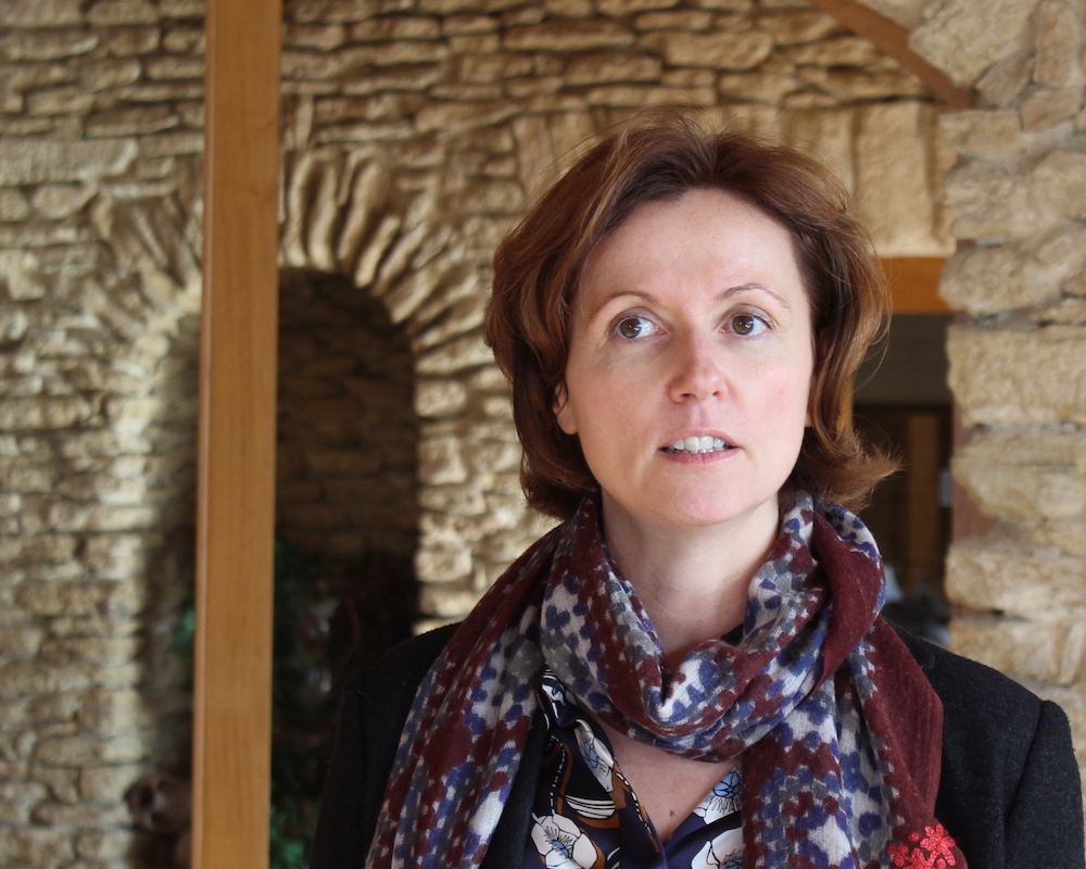 The GM at Ch. Nalys, Isabelle Ogier, leads a tour of the winery.