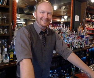 Mixologist and Made With Love's Toronto Ambassador steadies himself behind the wood at College Street Bar.