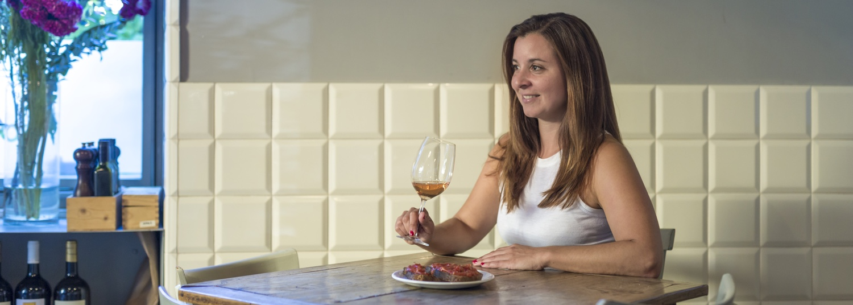 Katie Parla enjoys a glass of wine