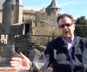 UK Winewriter Quentin Sadler relaxes with a glass of Languedoc white in the walled city of Carcassonne.