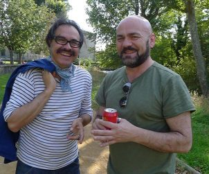 Finitribe's Davie Miller shares a laugh with the Convenanza festival's Bernie Fabre in Carcassonne.