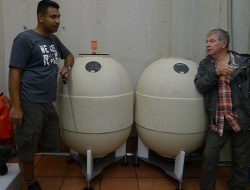 Winemaker Shiraz Mottiar and Vigneron Martin Malivoire discuss the benefits of skin contact over a couple of ceramic eggs... the concrete tanks are actually outdoors.