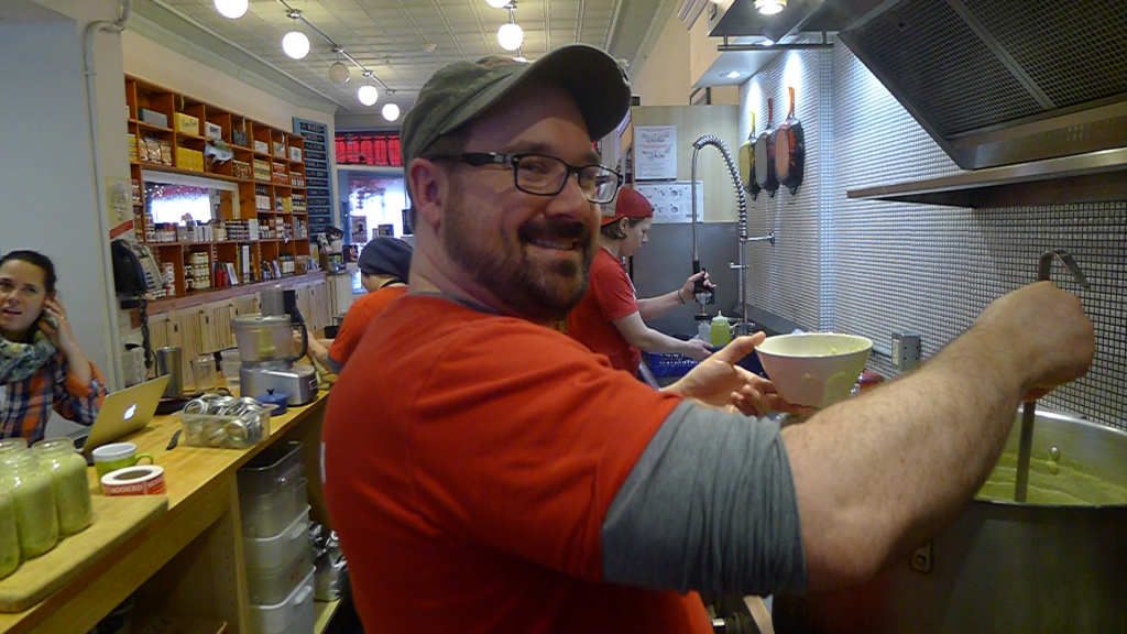 Kendall Collingwood cooking up some mighty fine, warming chowder at Hooked in Leslieville.