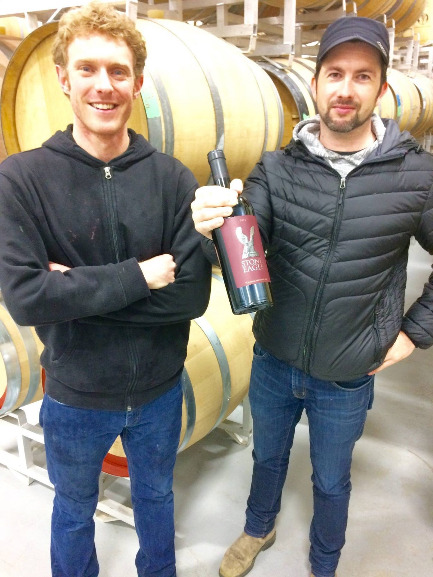 Winemaker Adam Pearce and Assistant Winemaker Trevor Ingham cradle a hefty bottle of 2012 Two Sisters Stone Eagle, Niagara River VQA.