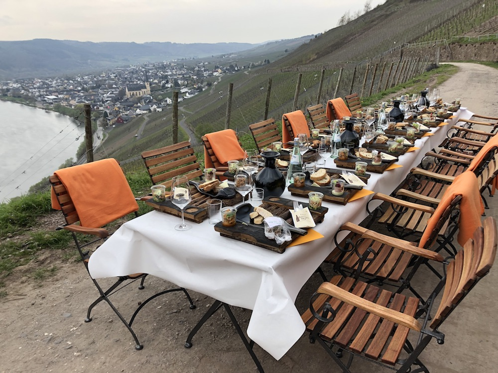 An open-air lunch in the Weingut Hüls Kröver Nacktarsch vineyards, Mosel.