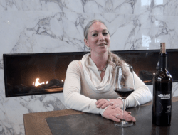 Winemaker Shauna White shows off the 2016 Edgerock Merlot.