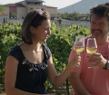Stavroula and Dimitrios Kioutsoukis of Kamara Estate, Thessaloniki, Greece enjoy a glass in their biodynamic vineyard.